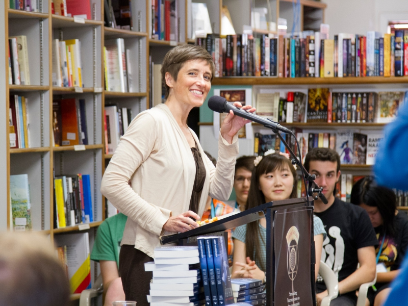 A writer speaking at Prairie Lights Bookstore